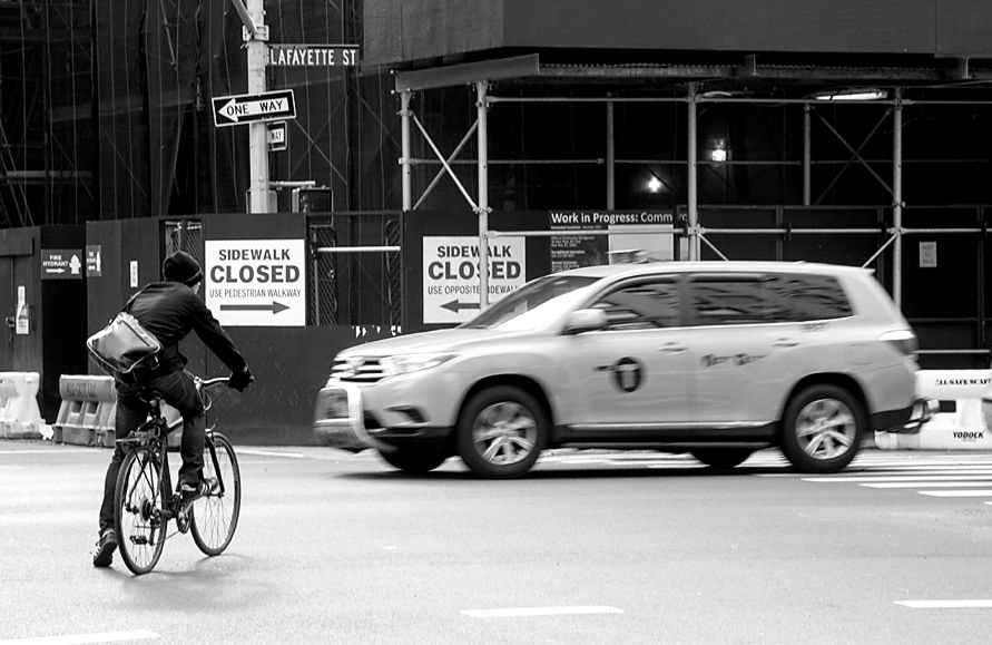 New York City.  Bicycle and Cab