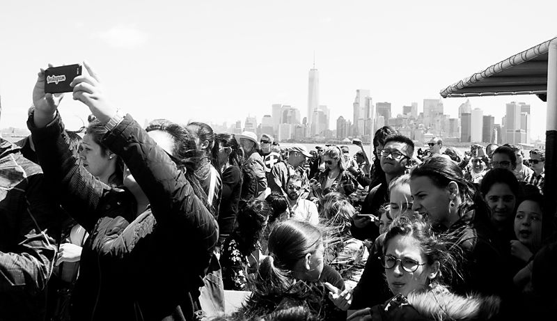 New York City.  Crowd and Manhattan Skyline