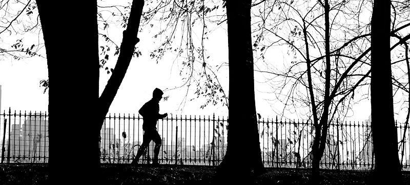 New York City.  Silhouetted Jogger