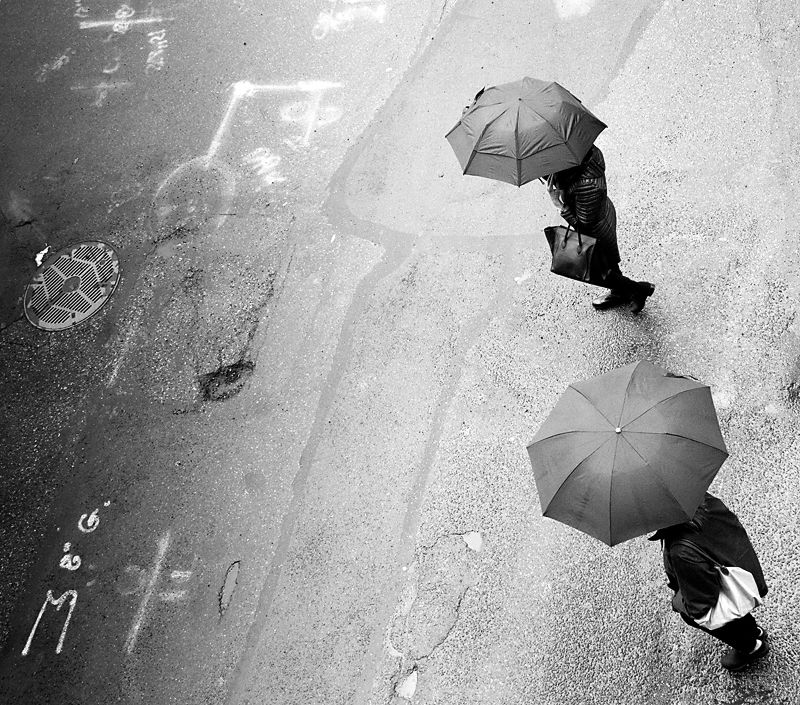 New York City.  Two Umbrellas